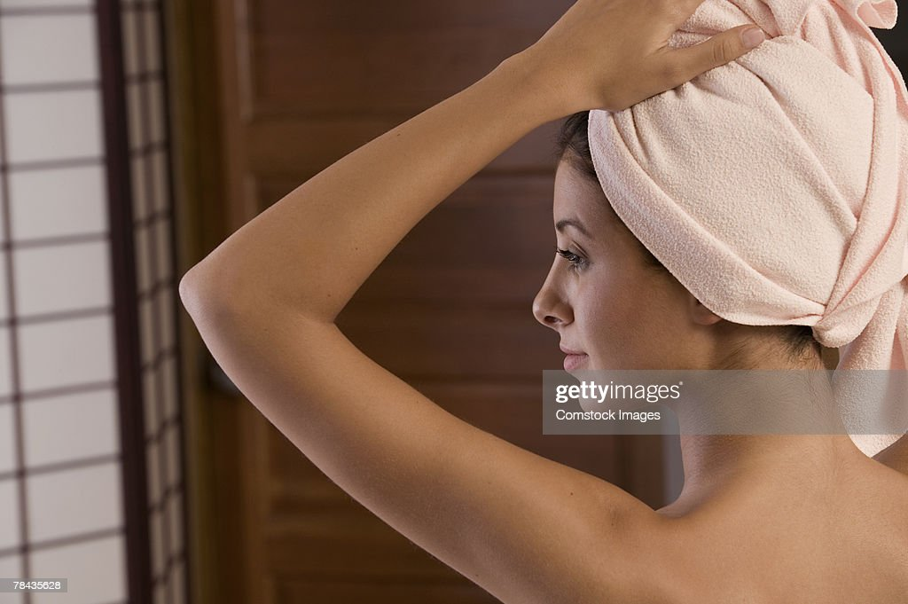 Woman with hair wrapped in towel : Stockfoto