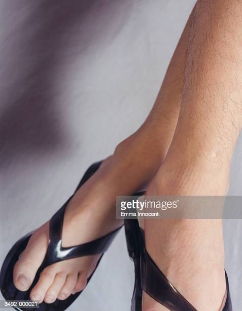 woman with hairy legs - hairy woman stock photos and pictures