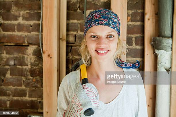Woman with hammer, portrait