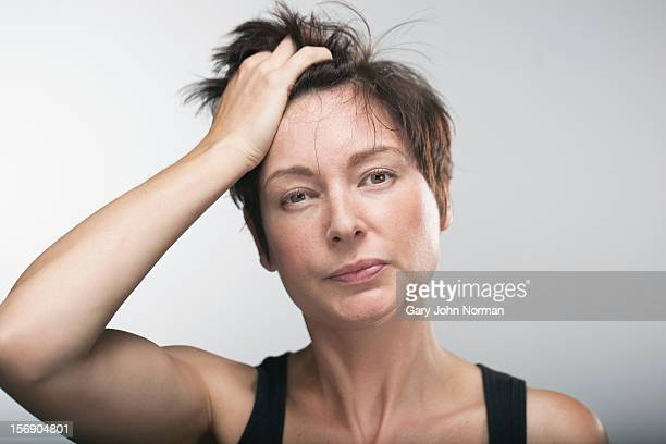 woman with hand in hair