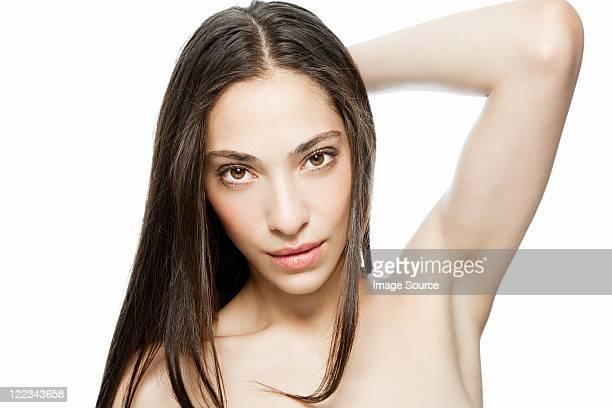 woman with hand in hair, portrait - セミヌード ストックフォトと画像