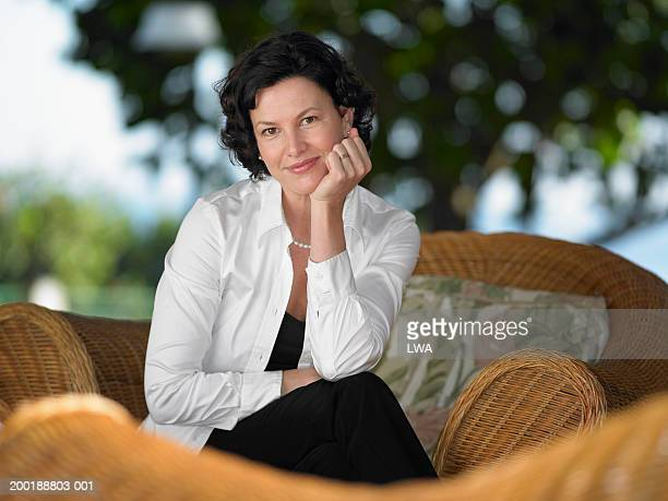 woman with hand on face, portrait - hand on chin stock pictures, royalty-free photos & images