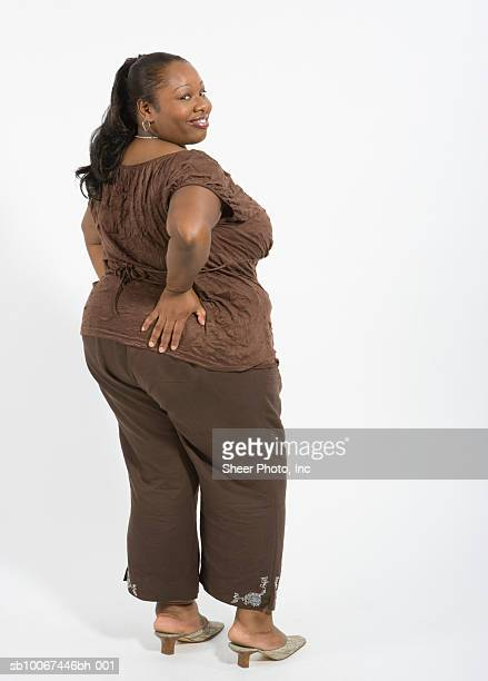 woman with hand on hip, rear view, portrait - images of fat black women stock photos and pictures