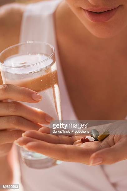 Woman with handful of vitamins