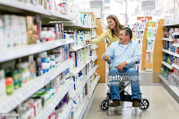 Woman with handicapped patient shopping at the pharmacy