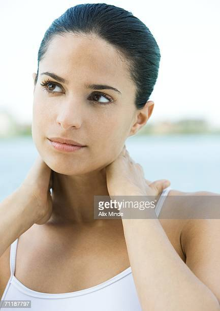 woman with hands behind neck - オールバック ストックフォトと画像
