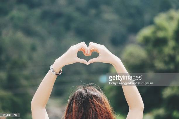 Woman With Hands In Heart Shape