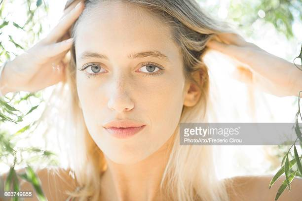 woman with hands on head outdoors, portrait - head massage stock photos and pictures