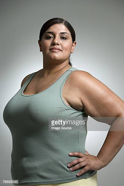 woman with hands on hips - chubby stock photos and pictures