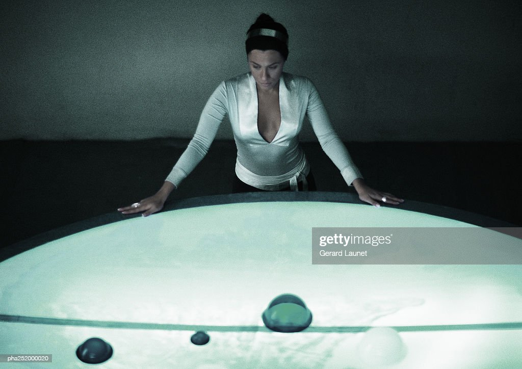Woman with hands on table, high angle view : Stockfoto