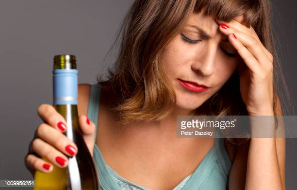 woman with hangover and depression - drunk woman stock pictures, royalty-free photos & images