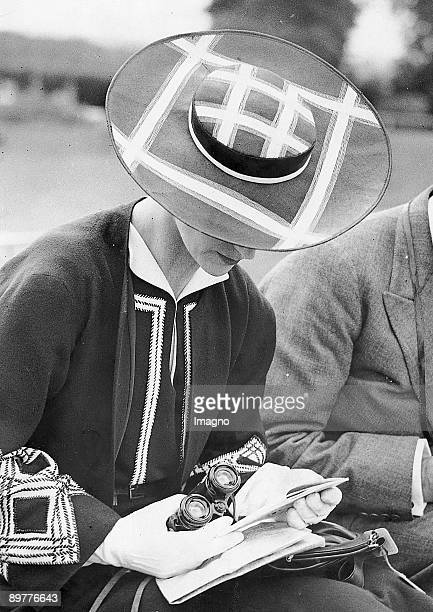 Woman with hat and binocular at a horse race. Photograph, 1937.