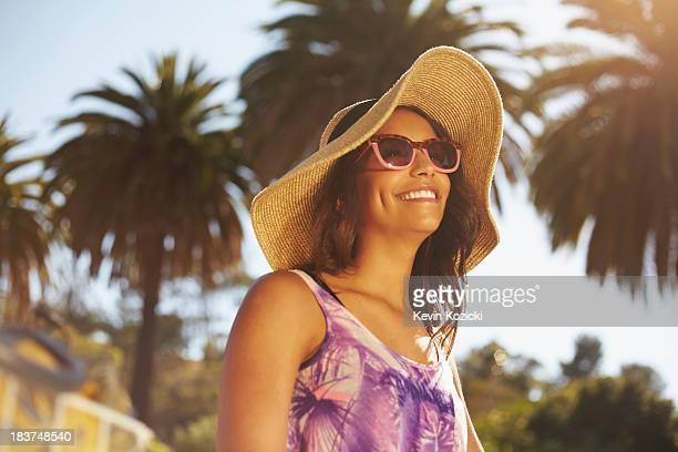 woman with hat and sunglasses - drooping stock photos and pictures