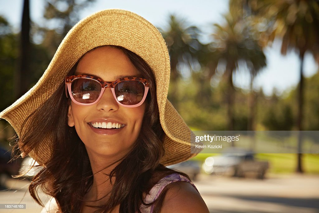 Woman with hat and sunglasses : Stock Photo