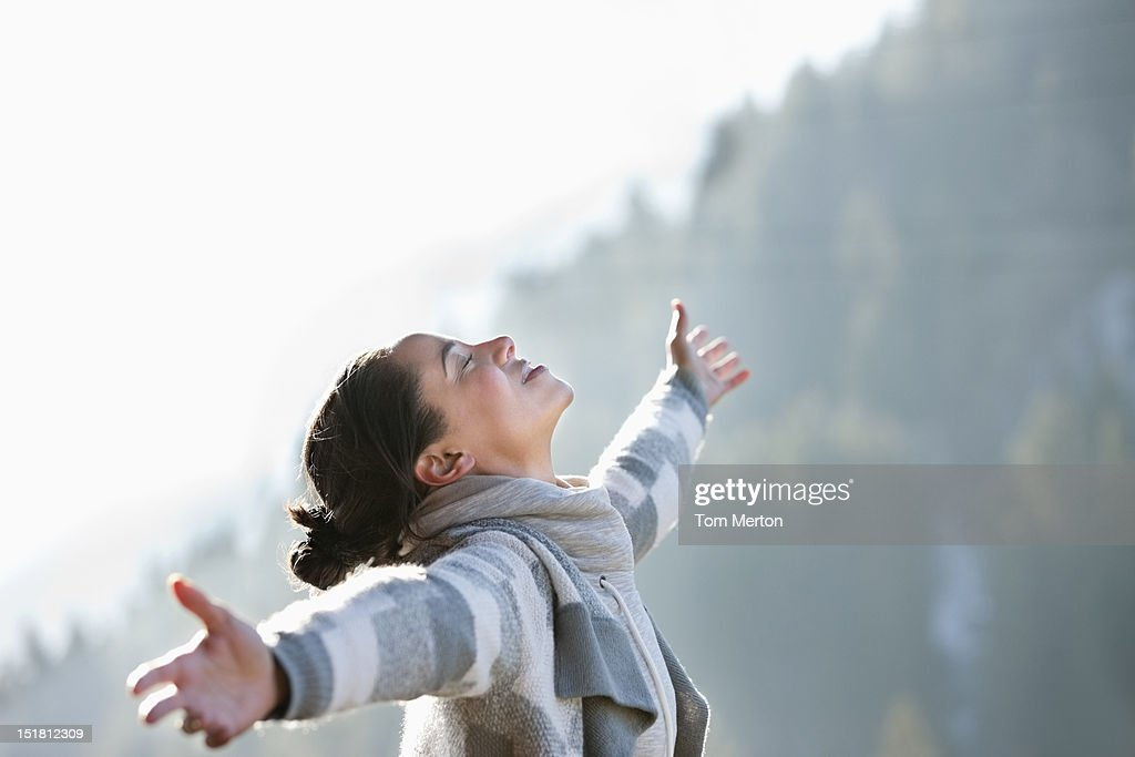Woman with head back and arms outstretched : Stock Photo