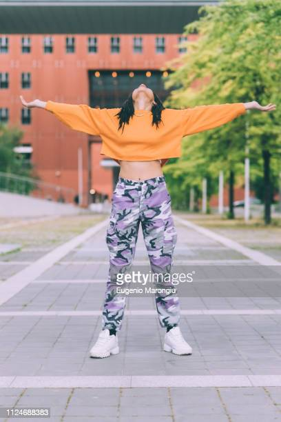 woman with head back and open arms, milan, italy - legs spread open stock photos and pictures