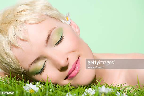 Woman with head on grass