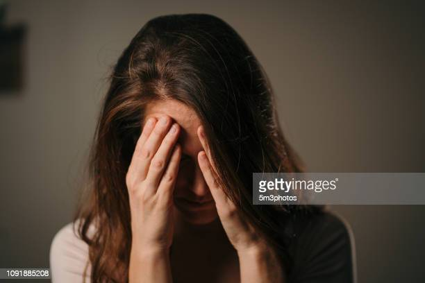 woman with headache pain - sadness stock pictures, royalty-free photos & images