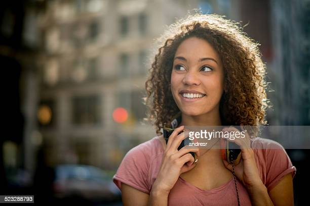 Woman with headphones in the city