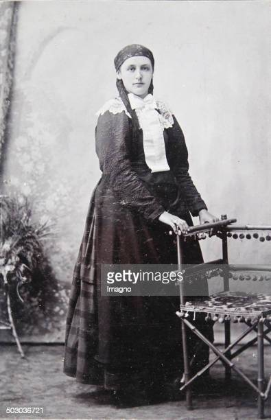 Woman with headscarf Lace shawl and white neck loop Full figure About 1895 Carte de visite photograph by August Töke Bruck an der Leitha and kuk...