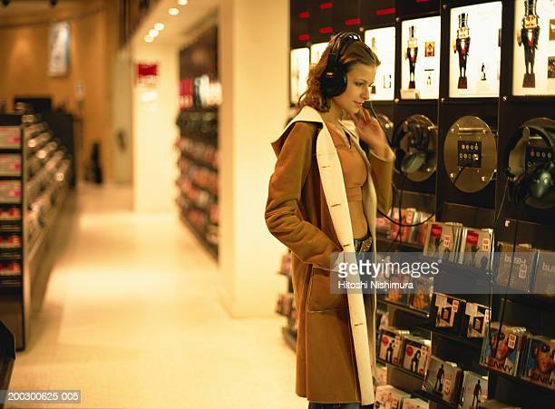 Woman with headset at record store