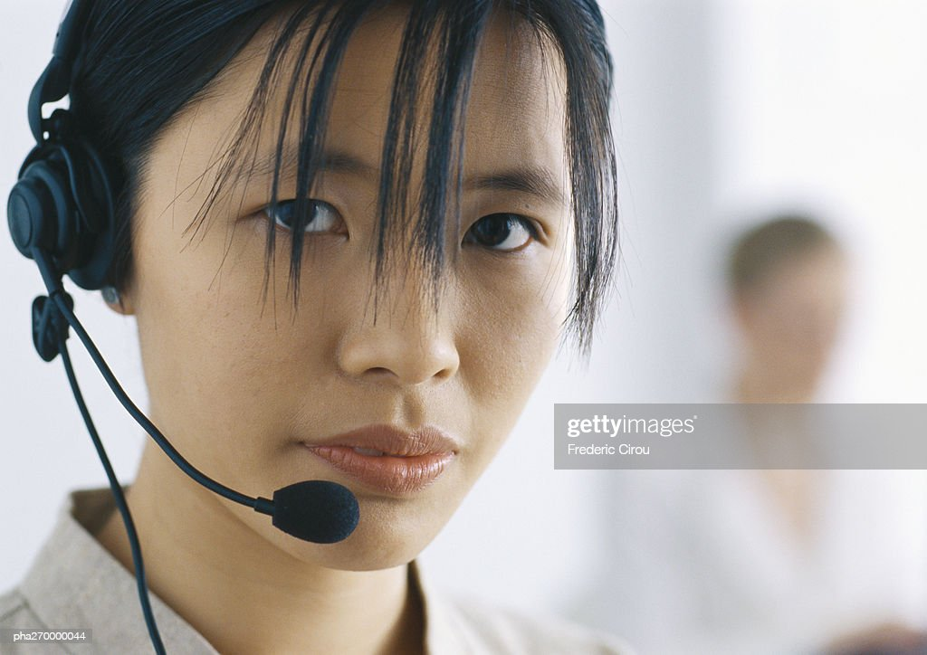 Woman with headset looking at camera : Stockfoto