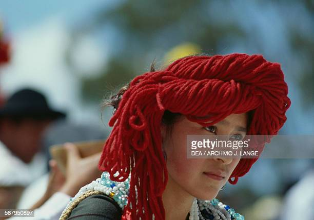 Woman with headwear and wearing a traditional costume during the celebrations at the Guelaguetza festival Oaxaca Mexico