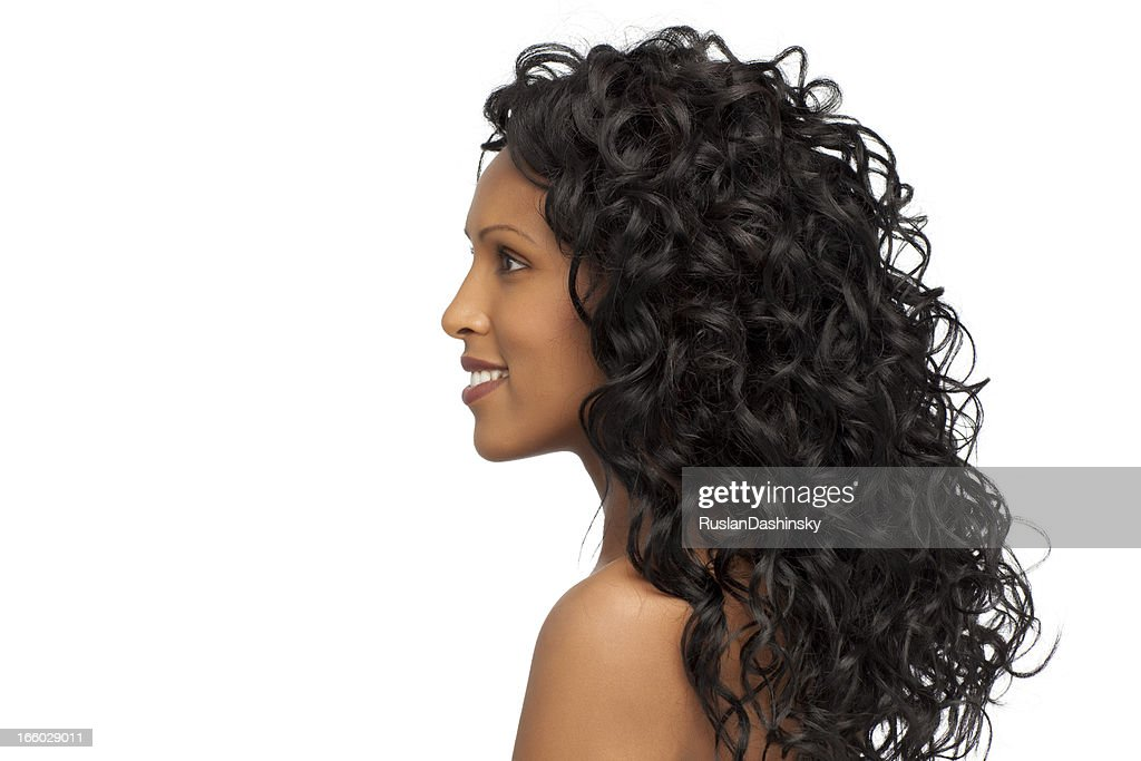Woman with healthy curly hair. : Stock Photo
