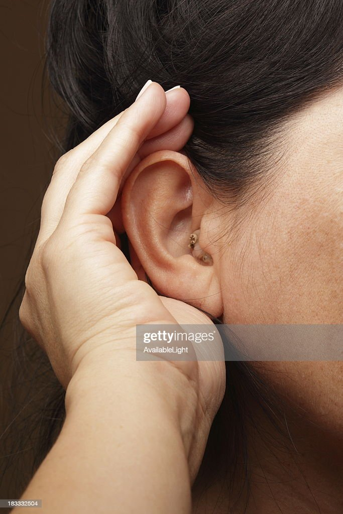 Woman With Hearing Aid Struggles to Hear : Stock Photo