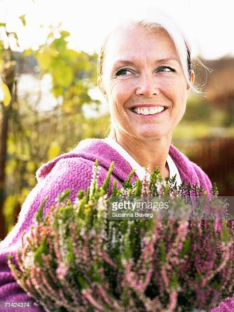 A woman with heather.