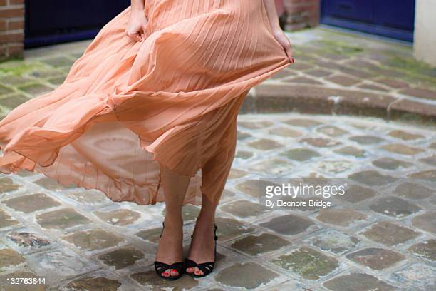 woman with heels - orange dress stock pictures, royalty-free photos & images