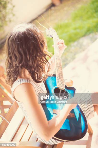 Woman with her acoustic guitar