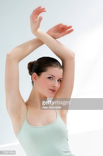 woman with her arms in the air - epilation maillot photos et images de collection