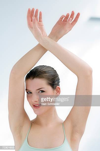 woman with her arms in the air (studio) - epilation maillot photos et images de collection