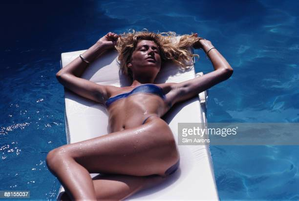 A woman with her body painted to give the impression she is wearing a blue bikini Porto Ercole Tuscany Italy September 1986