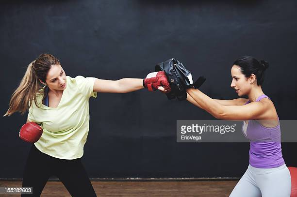 Woman With her boxing instructor
