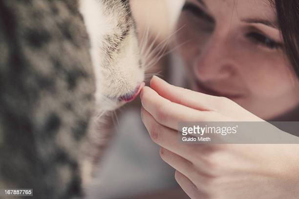 Woman with her cat, close-up
