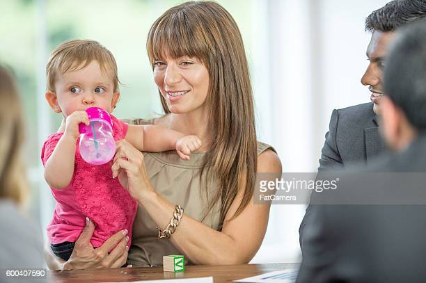 Woman with Her Child at Work