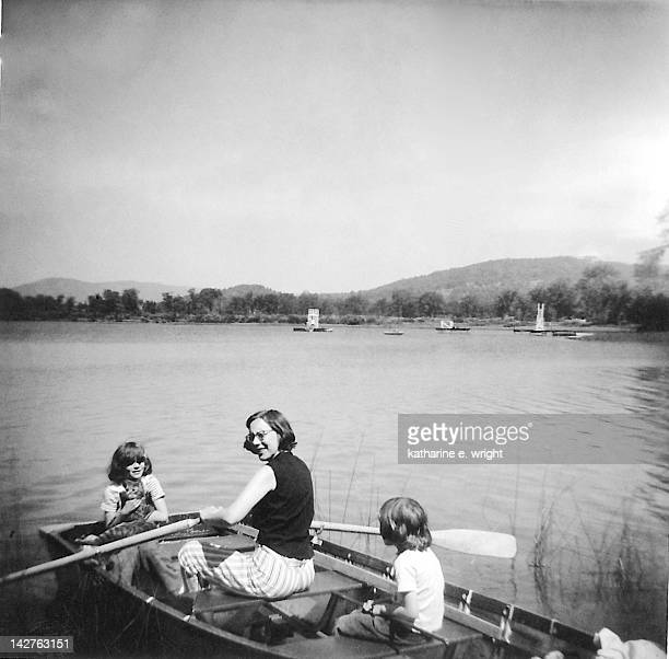 woman with her children in boat - 1950 1959 stock pictures, royalty-free photos & images