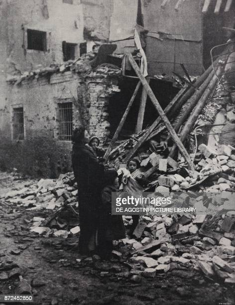 Woman with her children in front of the house destroyed by a bombing Padua Italy World War I from l'Illustrazione Italiana Year XLV No 2 January 13...