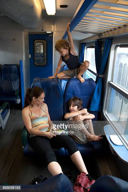 woman with her children in the train