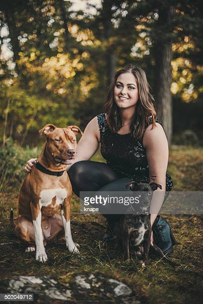 woman with her cute dogs - american staffordshire terrier stock photos and pictures