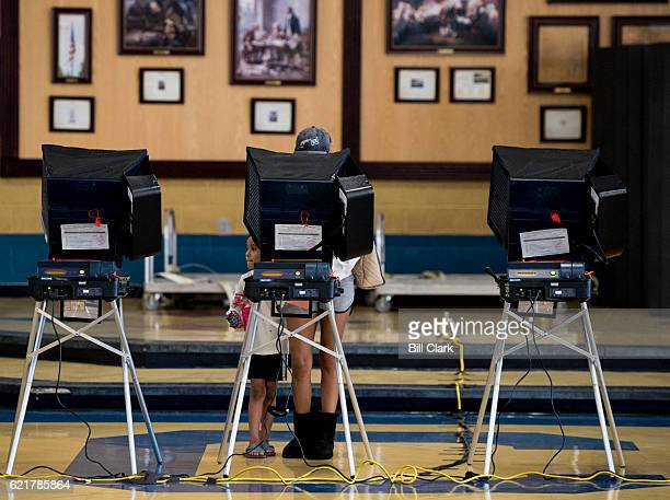 A woman with her daughter casts her vote at Cheyenne High School in North Las Vegas on Election Day Nov 8 2016 There were no lines at the location in...