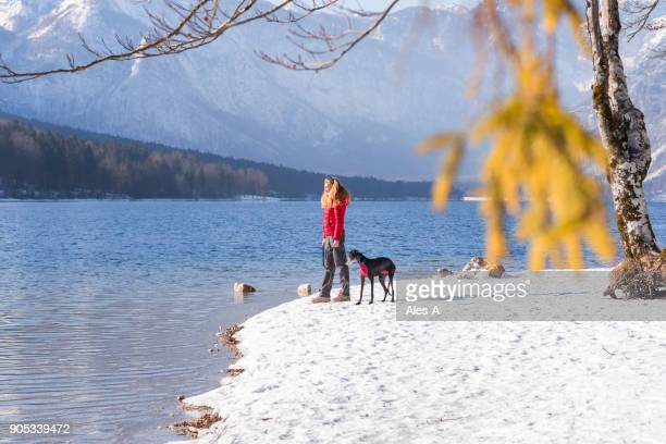 woman with her dog in the mountains - riverbank stock photos and pictures