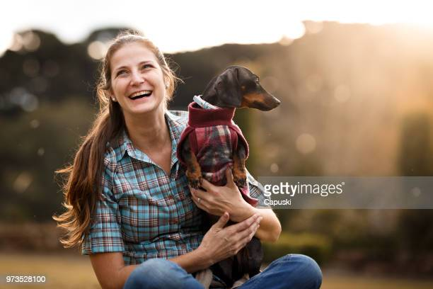 woman with her dog - pet equipment stock pictures, royalty-free photos & images