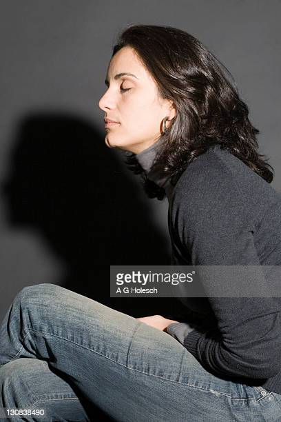 Woman with her eyes closed, symbolic image for depression
