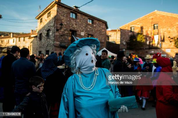 A woman with her face covered with a mask during a traditional carnival festival Every year Luzon hosts a carnival festival named 'Diablos y...