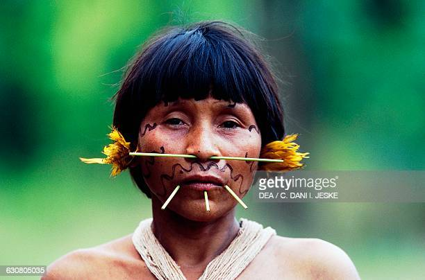 A woman with her face covered with ritual decoration Yanomami Indians from the Cavaroa tribe near the Siapa River Amazonas Guyana Venezuela