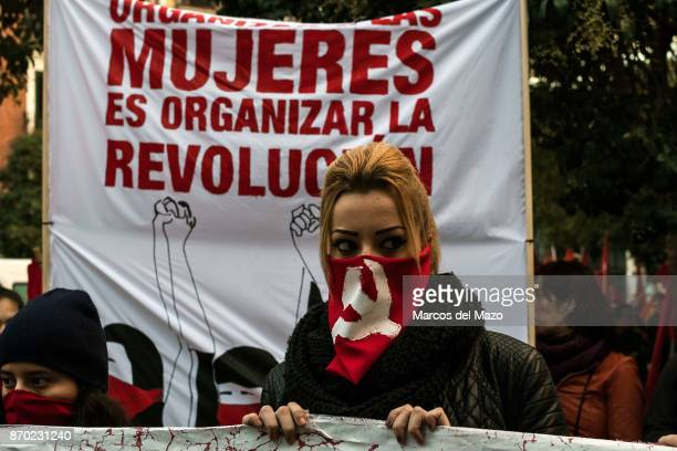 A woman with her face covered with soviet hammer and sickle during a demonstration for the 100th anniversary of the October Revolution