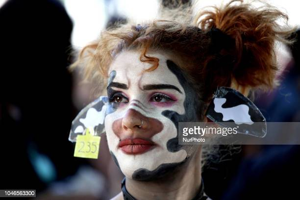A woman with her face painted as a cow is seen during 1st March For Animal Rights in Athens Greece on October 6 2018 to spread the message of animal...